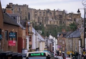 January 2012: A busy North Road, with the background of the iconic castle, shows a large variety of commercial activities and shops, most typically English. Most signs are readable, including Mason Owen, Knight Frank, Nobles Amusements, Tesco, Bradley Hall. A striking contrast between modern and ancient is presented here