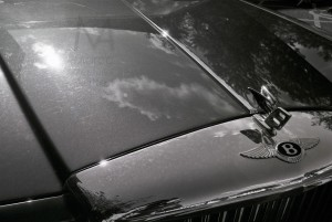 Durham, England - June 15, 2011: the bonnet of a Bentley parked in the outskirts of the city centre during a sunny day. Graduation ceremonies were going on at the University. Neopan 400