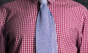 Blue woven silk tie on red cotton shirt