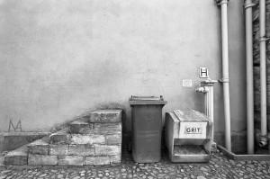 Grit (salt) container, hydrant attachment, rubbish bin, steps. Photographed in Durham, England. Kodak Professional Tri-X 400 [400TX]