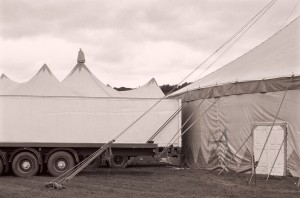 When it moves around Europe, the circus needs plenty of vehicles and trucks to carry stuff and artists around. Photographed in England, Sept. 2012  Neopan 400