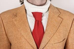 Unconventional elegance A silk necktie improperly worn over a turtleneck sweater.