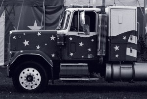 Truck, decorated with the American flag. Delta 3200
