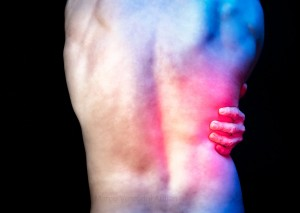 My back is painful and it shows! Red light illustrates back pain.