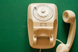 This telephone model was used in Italian homes a few decades ago. Large depth of focus. Green paper (textured) background.