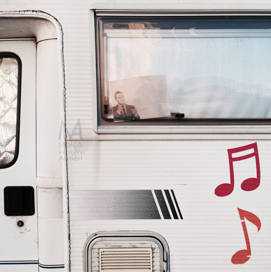 Rome, Italy - February 22, 2014: Alberto Sordi was a famous actor and showman. Romans loved and love him dearly. A photograph of him is visible through this camper van's window parked in Eur, Rome. iPhone 5