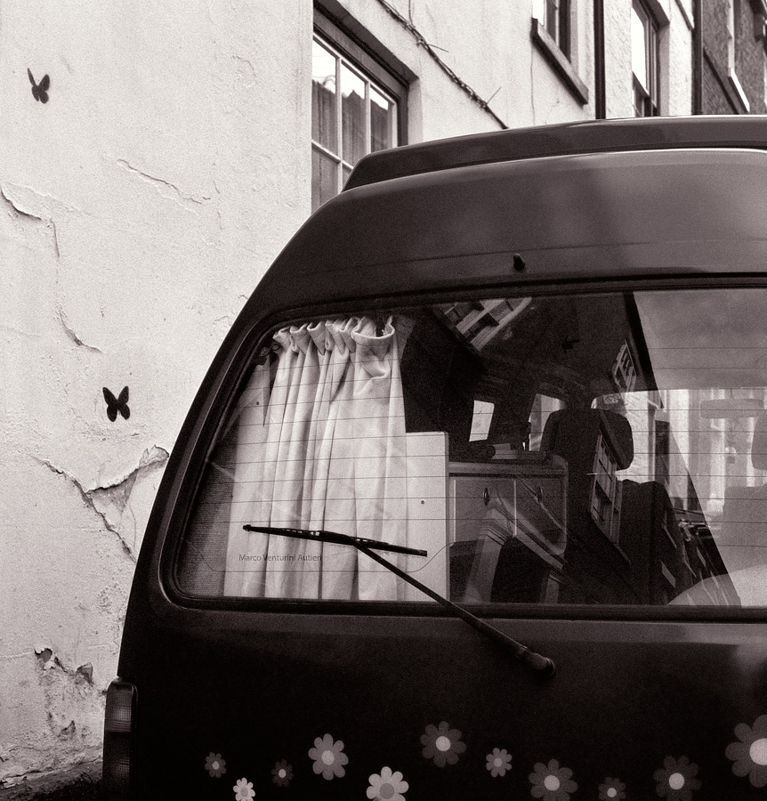 A nomadic van, happily decorated, parked in the street, decorated too. Durham, England. Bronica SQ-A, Delta 3200