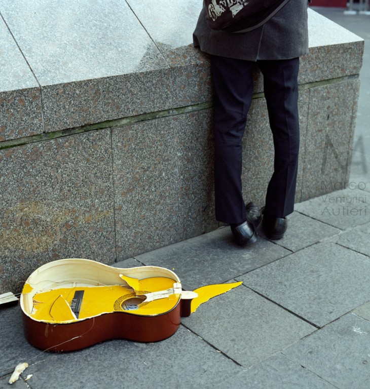 Somebody really lved this guitar. Photographed in Newcastle, England. Scan from 120 Portra 400