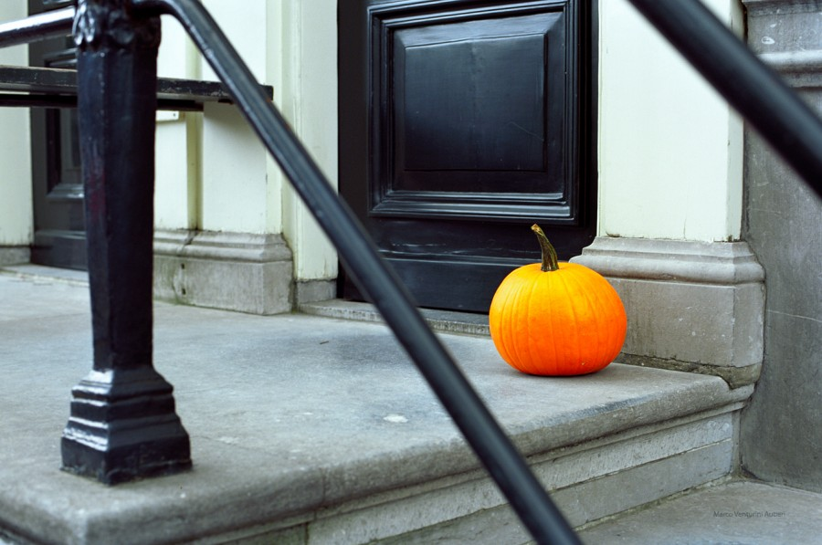 Pumpkin at the front door of a house in Amsterdam.