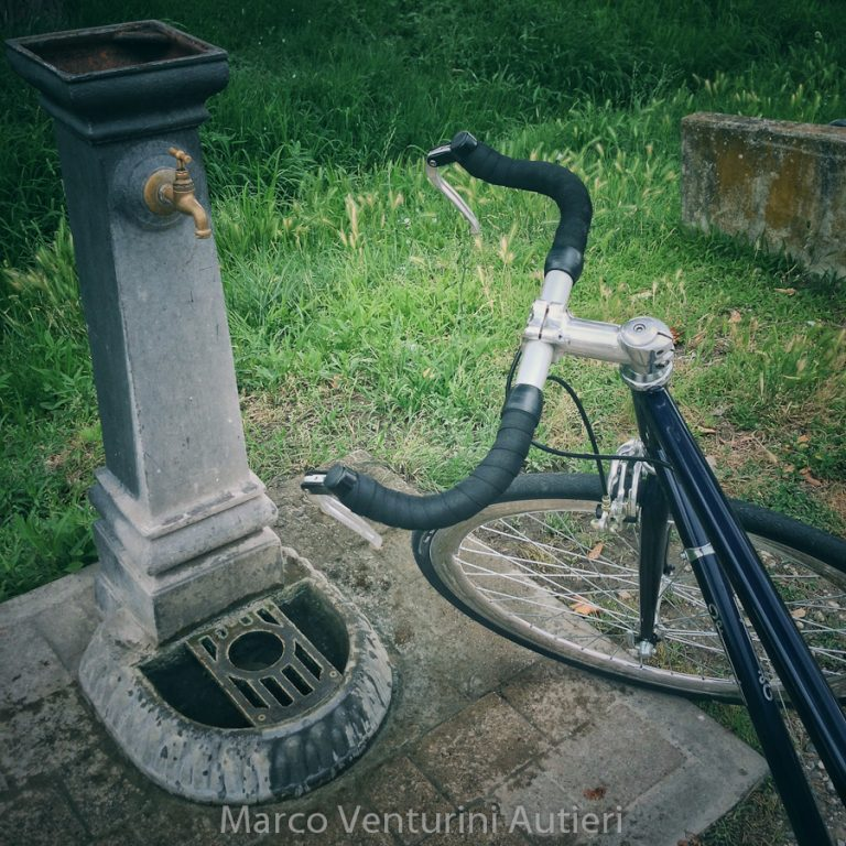 Since my bike is so gorgeous, including it in the frame comes natural. Public drinking fountain near the ancient aqueduct of Asciano
