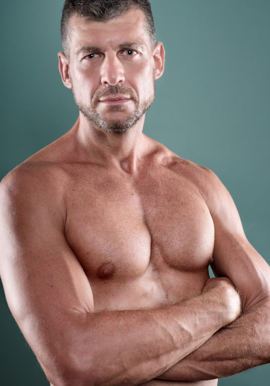 Muscular man, studio portrait, barechested