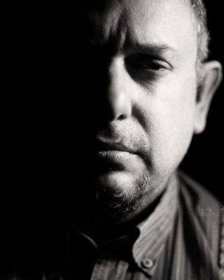 "Headshot portrait in ""chiaroscuro"" style"